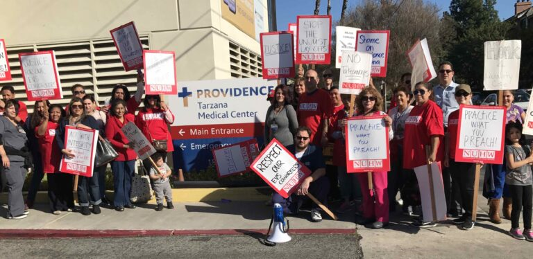 Providence Tarzana workers picket against mass layoffs of housekeepers
