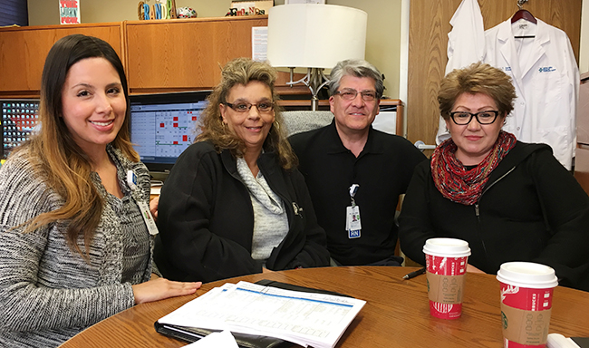 From left to right: Vanessa Gutierrez (Staffing Supervisor), Yolanda Zazueta (steward), Trini Juarez (Sr. Admin. Director of Patient Care Services), and Mary Serrano (steward) meet for monthly labor management meetings at Salinas Valley Memorial Hospital.